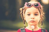 pic of lollipops  - Little girl with lollipop outdoor in the park - JPG