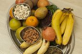 image of dry fruit  - Top View of Fruits and dry fruits from thread ceremony function - JPG