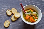 stock photo of vegetable soup  - vegetable soup with carrots green beans potatoes peas and onions into pieces and blend vegetables - JPG