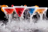 stock photo of vapor  - Cocktails with ice vapor on bar desk - JPG