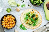 image of chickpea  - vegan tortilla with roasted broccoli and chickpeas and avocado sauce - JPG