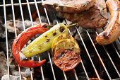 stock photo of grilled sausage  - vegetables grilled and sausages and prok chop on the grill - JPG
