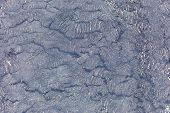 image of tar  - Tar texture with sand from a beach - JPG