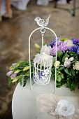 image of caged  - Wedding decor white with a bird cage in restaurant - JPG