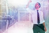image of clenched fist  - Businessman cheering with clenched fist against server room with towers - JPG
