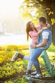 stock photo of roller-skating  - Young couple on roller skates in the park - JPG