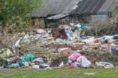 stock photo of landfills  - Pile of domestic garbage in landfill in village  - JPG