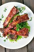 stock photo of roasted pork  - Roasted pork ribs on white plate top view - JPG