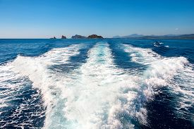 foto of boat  - Waves on blue sea behind the speed boat water in sunny day - JPG