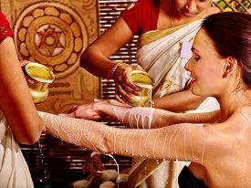 picture of panchakarma  - Woman having Ayurvedic spa treatment - JPG
