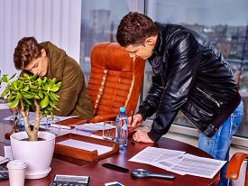 stock photo of raider  - Business men people sign documents in office - JPG