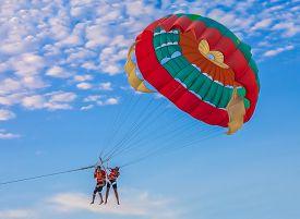 foto of parasailing  - Couple parasailing on Batu Feringghi beach in Penang Malaysia  - JPG