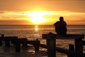 ������, ������: Lonely man watching the sunset at Port Philip Bay