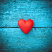 Red heart on the blue boards poster
