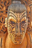Carved and tattooed Maori statue