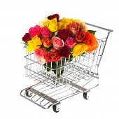 stock photo of flower shop  - shopping cart with colorful bouquet roses isolated over white - JPG