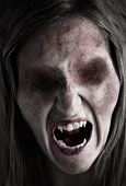 stock photo of morbid  - Portrait of an eyeless female ghoul or zombie - JPG