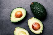 ..fresh Green Avocado  Over Wooden Table With Copy Space. Avocado Background Top View Image. poster