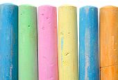 Colorful Large Chalk Sticks On A White Background. poster