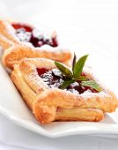 stock photo of french pastry  - Delicious Cherry puff pastry with powdered sugar - JPG