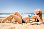 pic of swimsuit model  - beautiful red head bikini model lying on beach in the sun - JPG