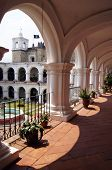 stock photo of escuela  - Arc and inner yard of monasterry Escuela de Cristo - JPG