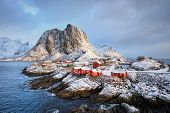 Famous tourist attraction Hamnoy fishing village on Lofoten Islands, Norway with red rorbu houses in poster