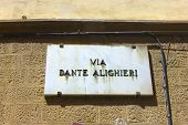 stock photo of alighieri  - Close up image of Via Dante Alighieri plaque in Florence Italy - JPG