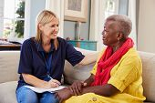 Female Support Worker Visits Senior Woman At Home poster