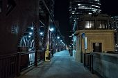 Chicago city vintage river drawbridge with tender house and urban downtown buildings at night. poster