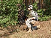 image of hider  - Soldier wearing ACU in the woodland smiling