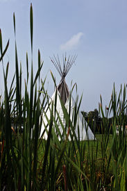 foto of tipi  - a traditional native canadian white tipi against blue sky - JPG