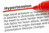 foto of hypertensive  - The word Hypertension underlined with red marker on white paper - JPG