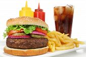 stock photo of hamburger-steak  - Big juicy hamburger served with crisp french fries and ice - JPG