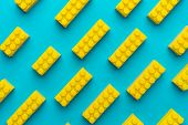 Top View Of Plastic Blocks Background. Flat Lay Image Of Toy Background Made With Yellow Building Bl poster