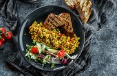Vegan Tofu Scramble With Vegetables, Salad And Toasted Bread In Plate Over Grey Background. Healthy  poster