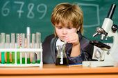 Education Concept. Wunderkind Experimenting With Chemistry. Boy Test Tubes Liquids Chemistry. Chemic poster