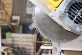 Close-up Stationary Circular Saw On A Carpentry Table On A Blurred Background Of A Carpentry Worksho poster