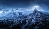 Mountains In Fog At Beautiful Night. Dreamy Landscape With Mountain Peaks, Stones, Grass, Blue Sky W poster