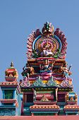 foto of saraswati  - Colourful sikhara at the top of a hindu temple in Madikeri - JPG