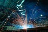 Welding Sparks  From Robot  In Manufacturing With Blur Focus, Used Is Background poster