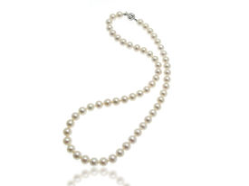 stock photo of collier  - White pearls collier on a white background - JPG