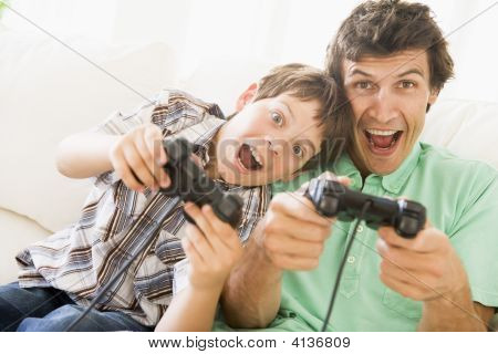poster of Man And Young Boy With Video Game Controllers Smiling
