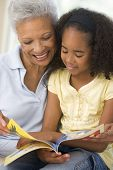 foto of girl reading book  - Grandmother and granddaughter reading together - JPG