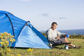 Man Camping Outdoors And Cooking poster