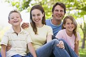foto of family fun  - Portrait of Families relaxing in park - JPG