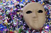paper mache carnival mask and confetti of different colors