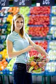 picture of grocery-shopping  - beautiful young woman with basket at the supermarket  - JPG