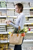 picture of grocery-shopping  - Young woman in the shopping mall with flowers - JPG