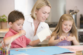 foto of mother child  - Woman doing art with children at home - JPG